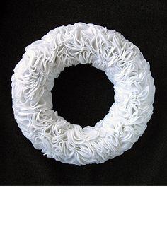Felt Wreath  http://www.designsponge.com/2009/12/diy-project-kristens-ruffly-felt-wreath.html