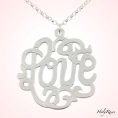 A beatiful sterling silver pendant with the word Love - monogram style