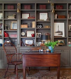 Leave space on bookshelves so there is room to incorporate other mementos besides books. Photos, clocks, and other curiosities make this bookcase feel more personal and show the homeowner's own personal style. If there aren't enough books to fill the entire bookcase, disperse them randomly throughout a large bookcase, and add your own personal mementos.