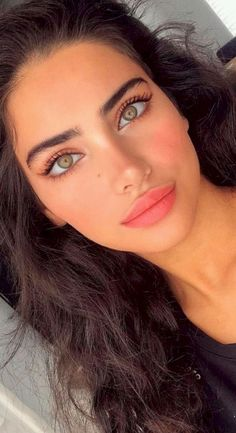 no makeup she's beautiful look at those eyes  natural