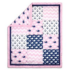 Pink and Blue Whales and Anchors Patchwork Baby Crib Quilt by The Peanut Shell  The Peanut Shell Cotton Quilt showcases a combination of navy blue and pink contemporary prints featuring whales, anchors, and chevron arranged in a classic patchwork design  Fabrics are 100% cotton sateen, a weave that results in a bright satin-like appearance and feel, providing the optimal mix of durability, beauty, breathability, and ease of care; polyester fiber fill provides the perfect amount of ligh...