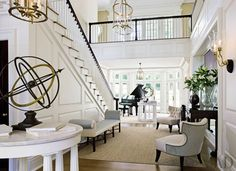 Designer Thomas Pheasant added a bay to brighten a Virginia home's entrance hall, where Luis Montoya and Leslie Ortiz& Two Plums is displayed with a pair of armillary spheres; Pheasant designed the chairs for Baker. Home Interior Design, Interior Architecture, Interior And Exterior, Interior Ideas, Design Entrée, House Design, Design Trends, Design Ideas, Architectural Digest