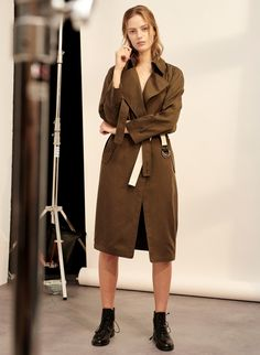 """The Babaton for Artizia Trench Coat ($245) is described as """"Tailored with exceptionally smooth, fluid fabric, the Lawson is one of Babaton's most-loved pieces. Their take on the timeless trench silhouette is updated with an open front and a cascading lapel for a more modern feel."""" The green hue is called 'monterey'."""