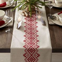 This casual, understated table runner accents the table with natural materials and embroidery inspired by Scandinavian folk art.