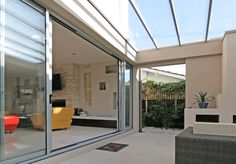 Stacker Door | Rylock Australia - rylock stacker sliding doors.  Can upgrade the flyscreens to be security screen inserts