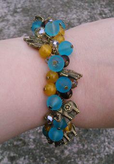 cluster bracelet in aqua, orange and brown with bronze elephants