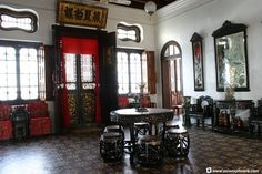The reception hall of Hai Kee Chan. Most of the furniture in this house are brought in as part of the Pinang Peranakan Mansion, and is not the original items in the house.