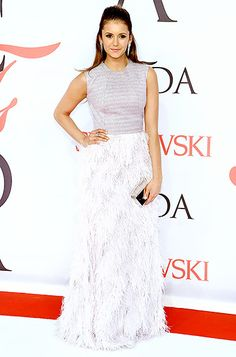 Nina Dobrev rocked a smoky-hued top paired with a feathered skirt, both by Lela Rose. A silver Lee Savage clutch and dangling earrings completed the ensemble.