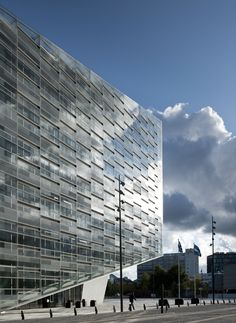 glass façade with varying transparencies; office exterior