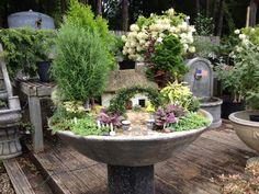 Fairy cottage in a bird bath