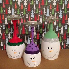 White elephant gifts! Wine glass snowman candle holders. Bought different sized wine glasses at the dollar tree then painted them to look like snowmen and put small votives on the top.