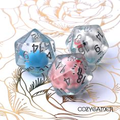Water Creatures D20s. Extra large 20mm D20s, you can pick a blue whale, white duck, or pink octopus. Playing Dice, Dice Bag, Gaming Accessories, White Ducks, Cat Paws, Magic The Gathering, Rose Buds, Dungeons And Dragons, Octopus
