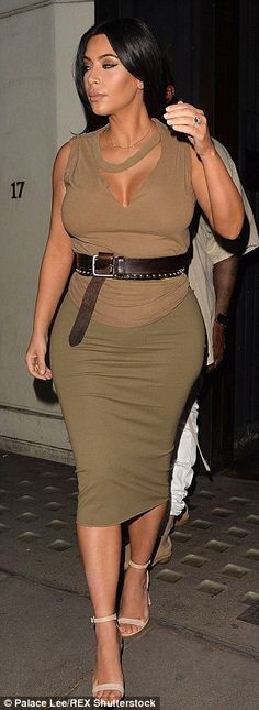 Struggling?Kim revealed she plans to wear 'simple' maternity wear this time round, adding, 'At this stage, I'm just trying to fit into the things that still fit me'