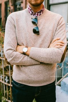 Love the cream sweater accentuating the gingham shirt underneath it.