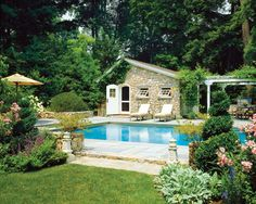 pool landscaping with pool house and patio