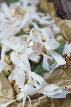 For a holiday inspired winter wedding, the bride and groom included bell wedding favors tied with ribbon and pine tree branches to ring in the new Mr. and Mrs. | Jillian & Joseph's Wintry Whitehouse Station, NJ Real Wedding by Vanessa Joy Photography
