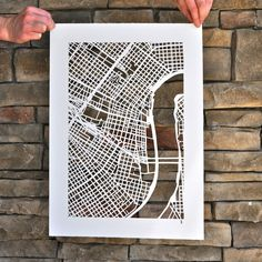 Map of New Orleans by architectural designer and artist Karen O'Leary. O'Leary reappropriates street maps into dazzling original work and giclée prints with intricate hand cuts or repetitive black ink lines.
