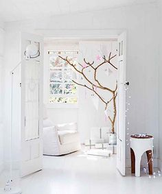 [the minimalist] Love the tree! real living magazine [styled by sarah ellison, photography by chris wames].