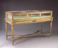 A Louis XVI style giltwood vitrine table