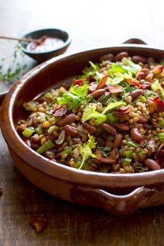 NYT Cooking: A play on Southern red beans and rice, this is a spicy, filling and highly nutritious dish. To make this meat-free, leave out the bacon, or substitute sliced mushrooms fried in olive oil for depth of flavor. But do use the hot sauce, preferably one with a vinegar bite to brighten up the dense heartiness of beans and grains.