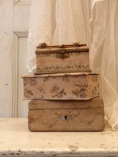 Beautiful boxes covered in antique linen
