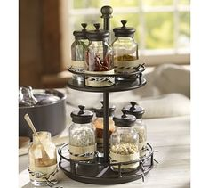 Rotary Spice Rack This looks especially cute since i buy spices in bulk canisters and bags at Costco