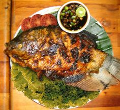Try this Grilled Fish (Ikan Bakar) Recipe, we hope you enjoy! Fish Recipes, Seafood Recipes, Asian Recipes, Cooking Recipes, Ethnic Recipes, Tilapia Recipes, Punch Recipes, Filipino Recipes, Malaysian Cuisine