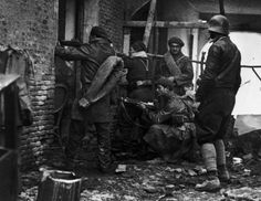 Madrid, Spain. Members of the International Brigades fight a house-to-house battle near the university campus. By Robert Capa, (November-December 1936)