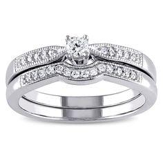 <li>Round white diamond bridal ring set</li> <li>Sterling silver jewelry</li> <li><a><a href='http://www.overstock.com/downloads/pdf/2010_RingSizing.pdf'><span class='links'>Click here for ring sizing guide</span></a></li>