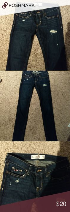 Hollister dark wash skinny jeans Hollister Dark wash skinny jeans, slightly destroyed. Never worn but washed once. Size 0 Short waist 24 length 29. Please check out my closet for other Hollister jeans! Hollister Jeans Skinny