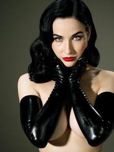 Burlesque star Dita Von Teese with black gloves & red lipstick.