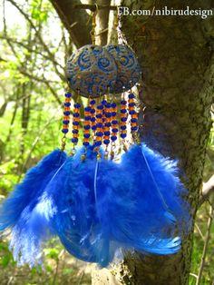 Blue handmade feather earrings  https://www.facebook.com/nibirudesign