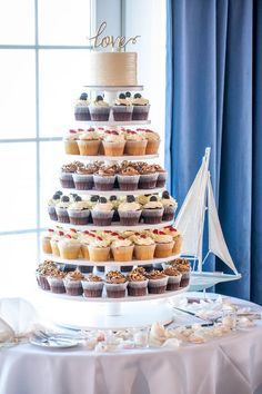 Cupcake tower for wedding -cupcake tower with assorted cupcakes and one tier cake {One Fine Day}