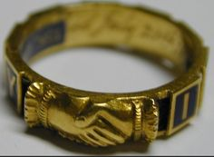 Gold mourning ring with clasped hands, c. 1890