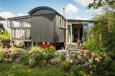 This rustic bohemian abode is set off the beaten track just 10 minutes from Watergate Bay, a pared-back yet sumptuous hideaway with heavy French linens and tarnished metals contrasting beautifully. Natural Swimming Ponds, Natural Pond, One Room Cabins, Cabins In The Woods, Cornish Beaches, Cornwall Cottages, Self Catering Cottages, Great Days Out, Camper Renovation