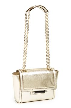 Slinging this shiny gold Diane von Furstenberg crossbody over the shoulder.