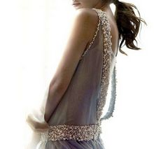 This is so pretty with its sheer light blue fabric and beautiful bead work