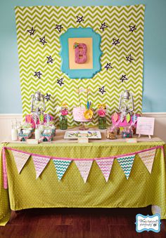 Amazing camping  birthday party, featuring many other things I've pinned (tent cookies, felt leaf garland, tents for each kid, etc)