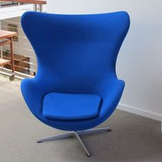 An original Arne Jacobsen Egg Chair. Manufactured by Fritz Hansen, Denmark. Designed in 1958 for lobby of the SAS Royal Hotel Copenhagen. Blue wool fabric. In excellent condition. No marks. $7700.00. A real eye catcher! [Ref: 279]