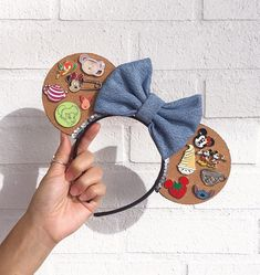 Looking for a fun and unique way to display your pins? The Pin Trading Cork Mickey Ears combine a love of Mickey Ears & Pin Trading in the most perfect way. Pin Trading Cork Mickey Ears $28.00 (Etsy)