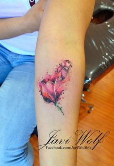 Watercolor Tulip.  Tattooed by @Javi Wolf
