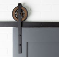 All Barn Door Hardware is Powder Coated. Our Artisan Barn Door Hardware kit offers looks very similar to our Artisan Top Mount Door Hardware Kit, except this kit features hardware with added straps that extend down on top of the door.