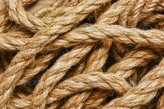 background of the ropes ... Bonding, attach, attached, background, brown, close-up, closeup, copyspace, cord, element, fastening, flexibility, hemp, join, jute, line, nobody, object, old, pattern, rope, ropes, rough, set, simple, strength, string, strong, symbol, template, texture, together, twine, variety, various, vintage