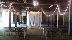 My friend @amynicole662 got married in this beautiful warehouse. Loved the decor. Fabric altar area, live band, burlap aisle, white lights hanging from the ceiling and candles on the wooden floor. #hickmanwedding