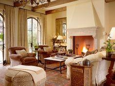 Living room sofa flowers table design coverlet lighting large room idea TV modern luxury fireplace