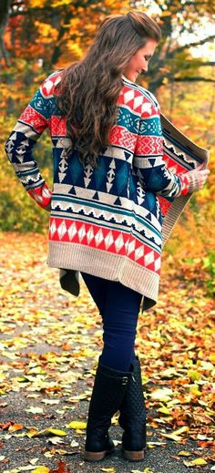 Colorful cardigan with dark blue jeans and long neck boots for fall