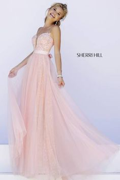 "SHERRI HILL Prom Dresses 2015 # 32229 Spaghetti straps hold up the fitted lace bodice with deep ""V"" plunge in back and front. A full length lace skirt shows through layers of tulle while a satin bow cinches the waist."