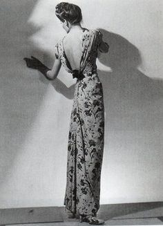 Elsa Schiaparelli 1930s Bias cut in the back long dress. Flower printed dress with pleat