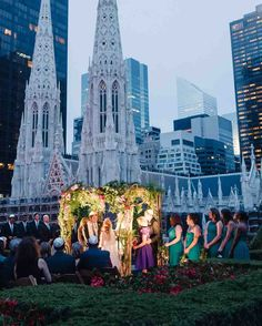 "15 Amazing Destination Wedding Photos | Martha Stewart Weddings - Lilly and Sean said ""I do"" beneath twinkling city lights on an overgrown rooftop garden overlooking Manhattan at 620 Loft and Garden. Across the street, St. Patrick's Cathedral brought gothic mystique to the botanical locale."