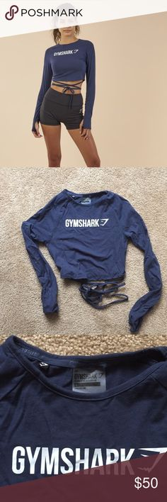 Gymshark Ribbon Crop Like new- never worn except to try on.  Purchased 3 of these shirts only to find out my gym doesn't allow crop tops!!!   Size small, navy blue Gymshark Tops Tees - Long Sleeve